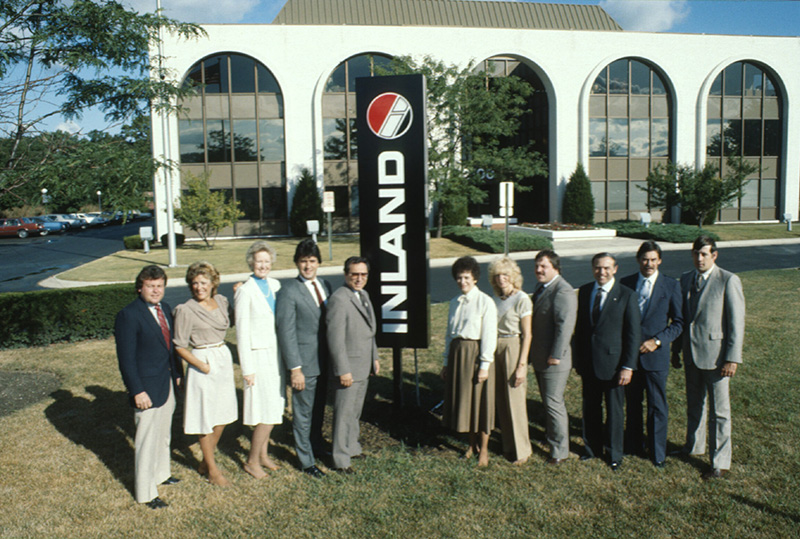 The 1985 Inland Acquisitions Team located in front of 2200 Clearwater Oak Brook, IL Corporate Office