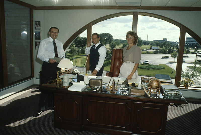 Joe Cosenza and members of the acquisition team working on a deal in 1985